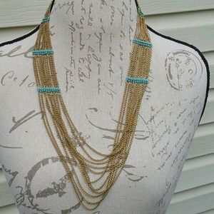 NWT faux gold and turquoise color layered necklace